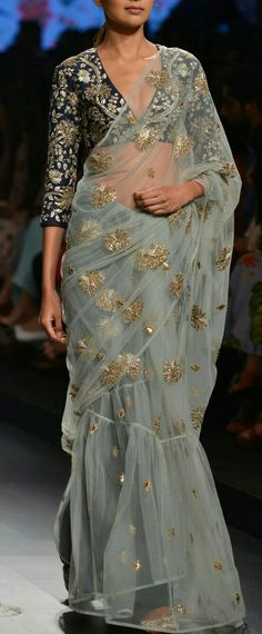 Payal Singhal presents Powder blue saree with navy blue floral applique blouse available only at Pernia's Pop Up Shop. Indian Attire, Indian Ethnic Wear, Saris, Indian Dresses, Indian Outfits, Anarkali, Lehenga Choli, Sabyasachi Sarees, Bollywood Saree