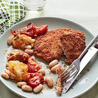 Breaded Pork Cutlets With Roasted Tomatoes And White Beans - flour - egg - baguette - grated parmesan - 1 lb. pork tenderloin - 1.5 lbs. tomatoes - dried oregano - 2 garlic cloves - extra virgin olive oil - cannellini beans - 2 lemons
