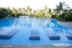 1 of the Pools at The Grand Mayan Nuevo Vallarta Resort ..these lounge chairs are the greatest invention EVER!!! LOVED LOVED these..so nice to be in the sun & stay cool at same time!