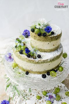 Matcha gooseberry mousse cake with black raspberries. Food photography by Candy Company