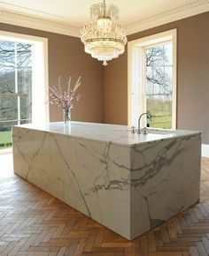 Earthy Natural Wood, Smooth Modern Marble and Elegant Traditional Moulding