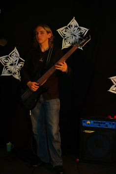 My son Paweł  playing his bass guitar  at his high school (2012)