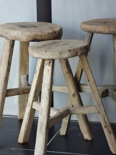 simple. natural. tie these in with charcoal grays. with creamy rich whites, perhaps in a matte finish. or even forget the white and try home accessories in the black family. industrial -meets rustic style. these stools have a ton of possibility. you could even two-tone them with a little miss mustard seed milk paint. Lean a little towards a scandinavian vibe. fun. love :)