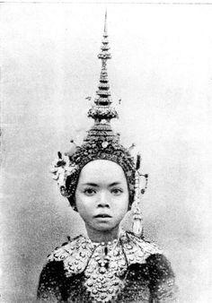 Burmese child dancer wearing a Mandalay headdress.