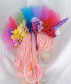 Purple unicorn horn rainbow unicorn headpiece colorful ribbons and flowers