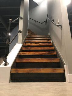 "Industrial ""burned"" basement stairs pipe handrail - ALL ABOUT Basement Steps, Basement Remodel Diy, Basement Flooring, Basement Renovations, Home Remodeling, Basement Walls, Basement Shelving, Dark Basement, Basement Waterproofing"