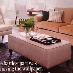 Ottoman as coffee table. Like arrangement of armchair, sofa, and ottoman
