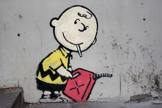 """""""Graffiti is one of the few tools you have if you have almost nothing. And even if you don't come up with a picture to cure world poverty you can make someone smile while they're having a p*ss,"""" ~ Banksy (Banging Your Head Against a Brick Wall)."""