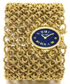 unusual yellow gold heavy bracelet with manual winding watch. - Sothebys