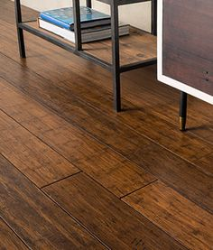 Designed for homeowners who want a rustic decor aesthetic without sacrificing elegance, Antique Java Fossilized® bamboo flooring brings back precious memories of that unforgettable weekend vacation in a tucked away mountain cabin. Uniquely distressed and aged to perfection, each plank is a meticulously hand scraped work of art producing a naturally aged look and feel.