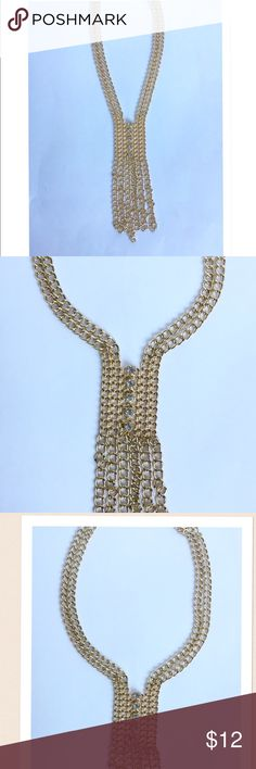 Gold Chains & Rhinestoned Necklace This Dynamic Gold Tone necklace makes a statement! It's great for outfits with a deep v-neck line.  NO TRADES! Jewelry Necklaces