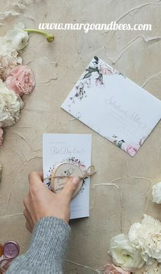 Save the date with wooden magnet and romantic flowers