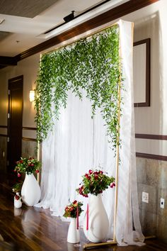 Hanging over the sweet heart table but using the door frame as the structure. Also adding blooms.