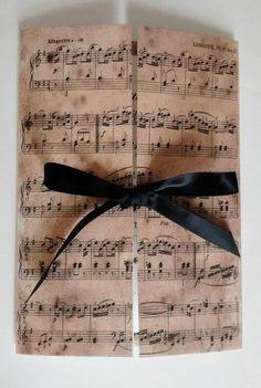 Elegant, classic and luxurious! If youre a music lover and even if youre not, you will love this handmade wedding invitation. Its printed on linen