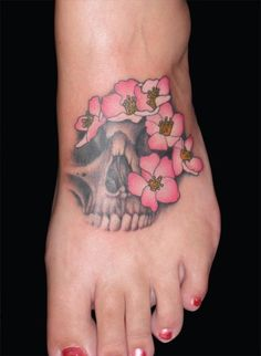 http://www.bestskulltattoos.com/wp-content/uploads/2011/01/skull-with-flowers-tattoo-design.jpg