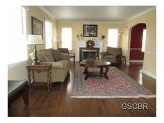 This home features formal Living room with wood floors, crown molding and gas log fireplace.
