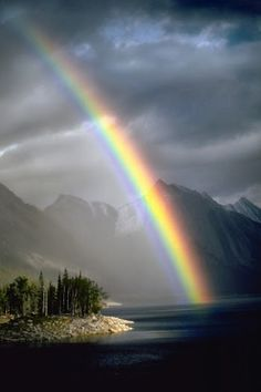A rainbow appears after an afternoon thunderstorm over the Medicine Lake at Jasper National Park in Alberta, Canada.