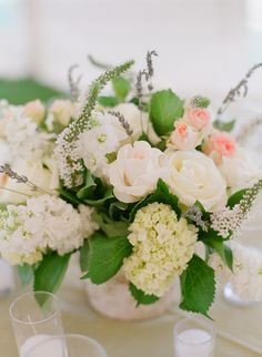Floral centerpiece with #whiteveronica #whiterose #pinkrose #hydrangea Photo by Carrie Patterson.