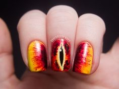 31 Day Challenge 2012Day 23: Inspired by a Movie These Eye of Sauron nails are inspired by the Lord of the Rings movie trilogy! My other two nails are painted solid black. You can see the other photos in my full blogpost. China Glaze Happy Go LuckyZoya MyrtaSally Hansen Insta Dri Rapid RedChina Glaze Prey TellOPI Black OnyxOPI Alpine Snow
