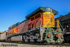 It's 2004 and a brand new brings up the rear of a loaded coal train that is going through a crew change from BNSF to NS at Norfolk Southern's Forrest Yard in Memphis. Locomotive Engine, Diesel Locomotive, Steam Locomotive, Train Wallpaper, Bnsf Railway, Burlington Northern, Norfolk Southern, Railroad Photography, Train Engines