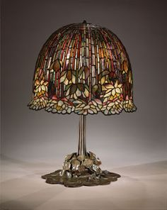 Lamp, Louis Comfort Tiffany (American, Tiffany Studios Leaded Favrile glass, bronzeThis water-lily table lamp is one of Tiffany's most successfully executed designs for his firm's well-known leaded-glass products.