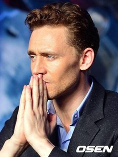 Tom Hiddleston doing his best Sherlock pose.