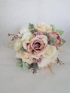 A stunning blush pink/peach silk bouquet. Perfect for a wedding! A lovely keep sake full of memories even after your special day. This lovely luxurious blush peach pink bridal bouquet is full with blush peach peonies, pink Peonies, blush peach Poppy, roses, pink Sedum, Gypsophilia, #weddingbouquets