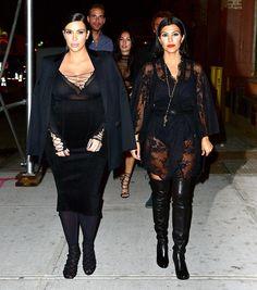Kim Kardashian walked around NYC with her sister, Kourtney, in a very revealing sheer top.