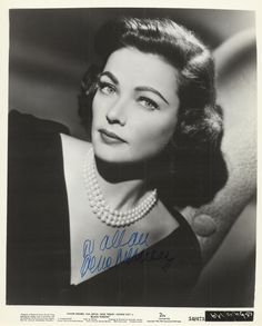 TIERNEY GENE: (1920-1991) American Actress, an Academy Award nominee. Signed and inscribed 8 x 10 photograph, an appealing original 20th Century Fox publicity portrait of the actress in a head and shoulders pose as Iris Denver from the mystery film Black Widow (1954). Signed in blue ink to the image, the conclusion of her surname running across a darker area.