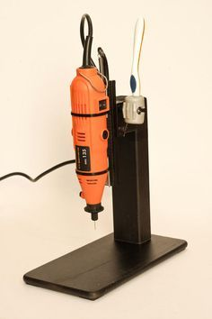 """When I begun to etch my custom pcb I felt the need to improve circuit drill tecnique. I drilled my first circuits by free-hand with my Dremel, but despite it's very fast, it's subject to errors, and it's also dangerous, because the drill bit is very narrow and weak. I've searched a column drill as the """"Proxxon Bench Drill Press TBM 115"""" but it's a little too expensive. I've found also a vertical stand for Dremel alt 50€, but it was a model with a single metal column as rail, si..."""