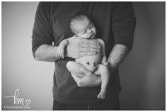 newborn and dad pose - newborn in dad's hands.