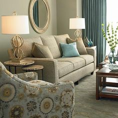 Beige sofa, blue curtains.