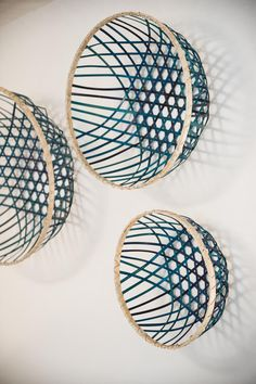 The HGTV Magazine team used blue baskets above the bed for an easy art piece.