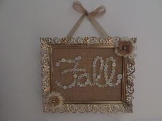 Fall sign made from a vintage metal frame, burlap and buttons