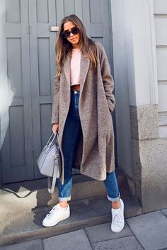 Taupe long coat, white crop t-shirt, mom jeans, white sneakers, brown sunglasses, grey handbag. #fashion #fashion2018 #longcoat #maxicoat #fallfashion #winterfashion #sneakers Fall outfit, winter outfit, minimal outfit, casual outfit, long coat outfit, street style, sneakers outfit, comfy outfit.