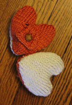 Free Knitting Pattern for Heartwarmers Heat Packs - These knitted hearts are filled with a microwavable rice or bead packet that makes them a wonderfully warm spot to be held or put in your pocket. Pictured project by sarahelise