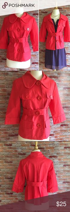 """Kenzie coral cropped trench Bright spring topper! Belted. 3/4 sleeves. Front utility pockets. Oversized collar. Large coral buttons. In excellent condition! 23""""L. 18"""" bust laying flat. 97/3 cotton, spandex. Size medium. *Polka dot dress shown is also for sale in my closet. Buy the look and save! Kensie Jackets & Coats"""