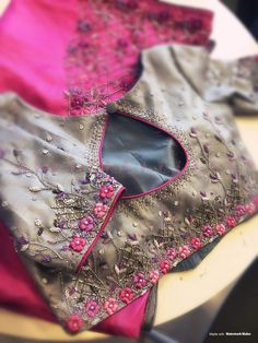 Beautifully designed and embroidered blouse. Those tiny details in shades of pin… Beautifully designed and embroidered blouse. Those tiny details in shades of pink and purple are simply astounding! Simple Blouse Designs, Stylish Blouse Design, Fancy Blouse Designs, Blouse Neck Designs, Wedding Saree Blouse Designs, Wedding Blouses, Silk Saree Blouse Designs, Designer Blouse Patterns, Embroidered Blouse