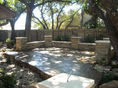 Flagstone patio with columns with a dry creek bed running through the middle. Great for entertaining and relaxing.