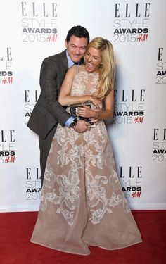 Luke Evans with his Actor of the Year award with award presenter Ellie Goulding during the Elle Style Awards 2015 at Sky Garden @ The Walkie Talkie Tower on February 24, 2015 in London, England.