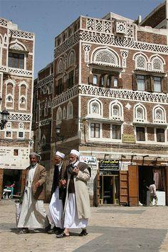 Old bearded men walking in the street - Yemen