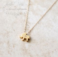 The Lucky Elephant . Gold Elephant Necklace .  Personalized Necklace . Elephant Initial Necklace . Elephant Jewelry . Custom Initial Gifts. $32.00, via Etsy.