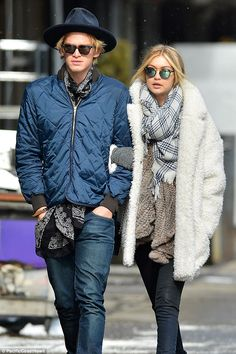 Baby it\'s cold outside! Gigi Hadid walks arm in arm with boyfriend Cody Simpson through th...
