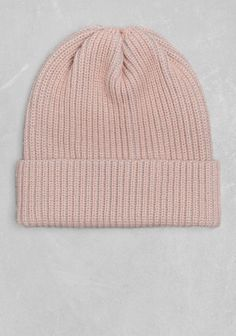 A thick wool beanie with a round silhouette and distinctive rib knitting.