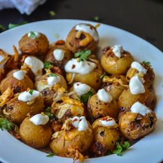 Cheesy Roasted Baby Potatoes with Sour Cream Recipe Side Dishes with potatoes, sea salt, garlic, rosemary, paprika, black pepper, lime, sugar, oil, shredded cheddar cheese, cheese, cream yogurt, parsley, chili flakes