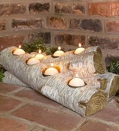 Artificial log candle-holder for inside the fireplace, from Plow & Hearth... Wonder if I could make my own with real logs??