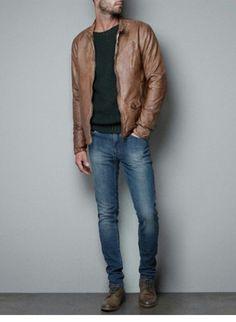 Shop this look on Lookastic: https://lookastic.com/men/looks/brown-bomber-jacket-dark-green-crew-neck-sweater-blue-jeans-brown-boots/3293 — Blue Jeans — Dark Green Crew-neck Sweater — Brown Leather Bomber Jacket — Brown Leather Boots