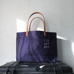 "Tote bag with wax canvas. I have stenciled ""152 207 269″  IND_BNP_0269 W 46cm H 27cm D12cm Handle 46cm"