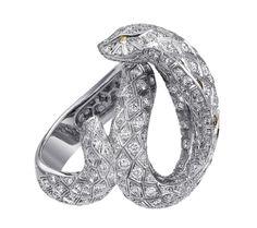 Snake-motif ring. Platinum, brown diamond eyes, diamonds. PHOTO: Vincent Wulveryck © Cartier 2011