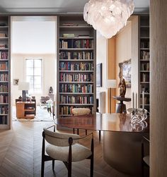 Functional urban luxury in a TriBeCa apartment. Custom rosewood top table, Vistosi disc chandelier, and cerused oak paneling. Interior Design Themes, Office Interior Design, Office Interiors, Luxury Interior, Interior Architecture, Nyc Real Estate, Home Libraries, Home Ownership, Trends